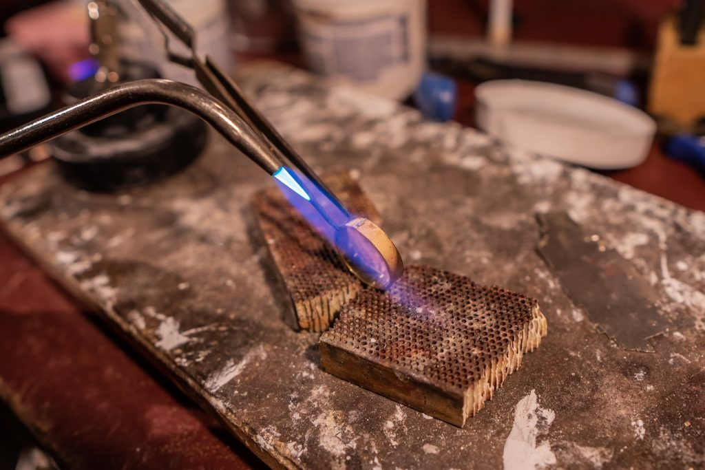 Soldering the edges of the ring together.