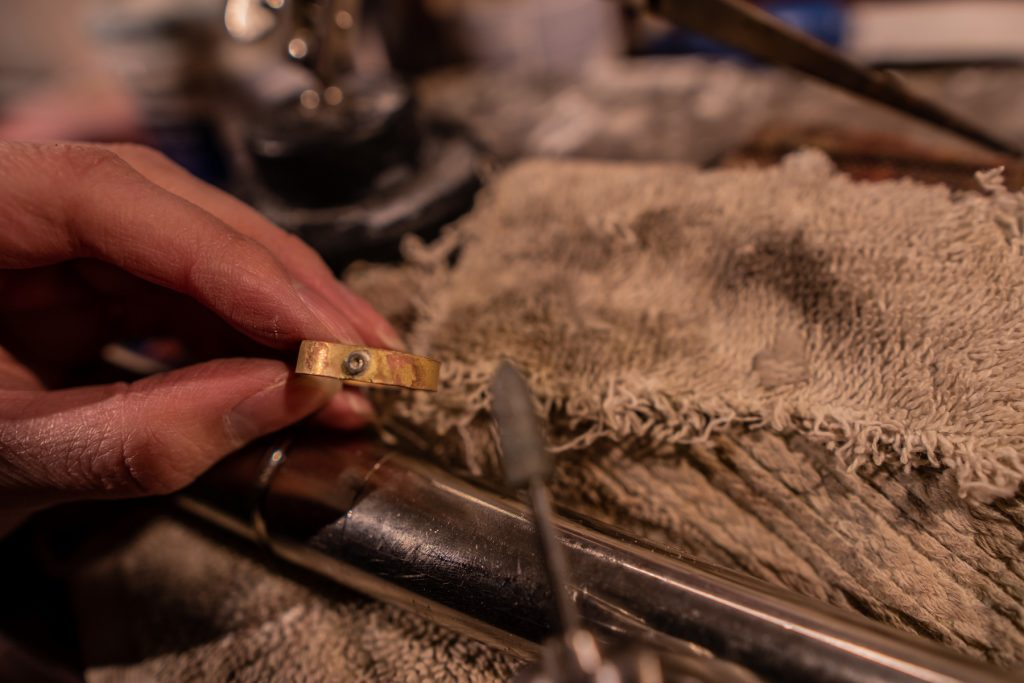 Filing the entire ring to create smoothness and shine.